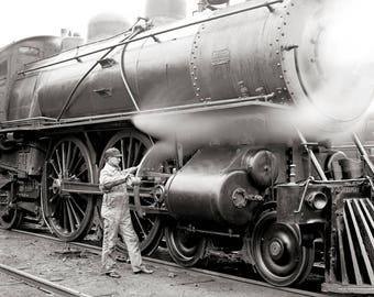 Engineer Oiling Locomotive, 1904. Vintage Photo Reproduction Poster Print. Black & White Photograph. Train, Railroad, Railway, Historical.