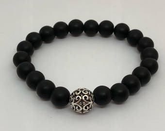 Matte Black Onyx with a silver carved focal bead beaded bracelet