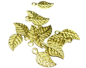 Set of 20 leaf shaped charms, in golden brass, 13 * 6 mm