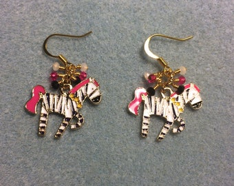 Black, white and hot pink striped enamel zebra charm dangle earrings adorned with tiny black, white and hot pink Chinese crystal beads.