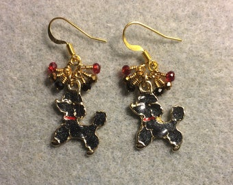 Black and red enamel poodle charm earrings adorned with tiny dangling black, red, and gold Chinese crystal beads.