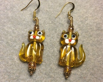 Translucent light amber lampwork cat bead earrings adorned with amber Czech glass beads.