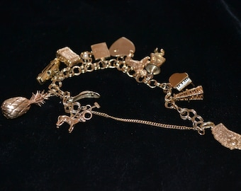 14 KT Yellow Gold Charm Bracelet with 14 14k Gold Charms