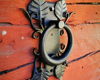 Hand forged steel door knocker, unique ornamental design.