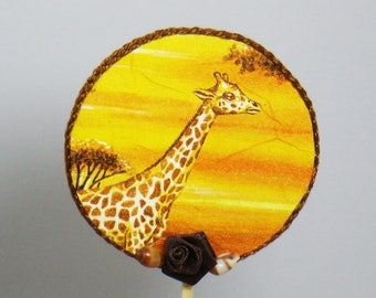 Decorative stick giraffe in the Savannah in Orange tones