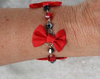 Red and black bracelet with bow ties