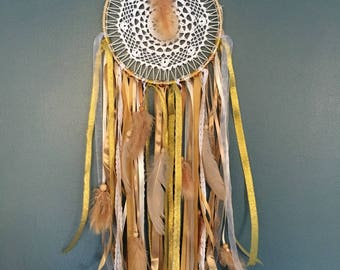 Dream catcher in white and gold tones