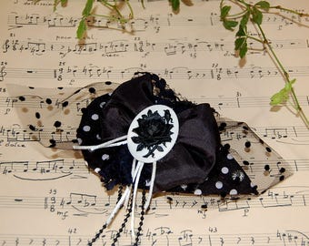 Bibi twist vintage black and white polka dots with cameo. Festive headpiece for cocktail or ceremony