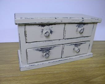 Four drawer apothecary table or counter cabinet. Distressed buttermilk with lamp black paint.