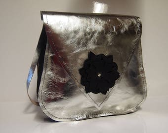 Silver colored leather shoulder bag.