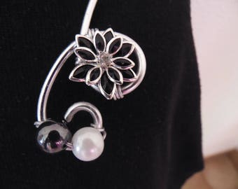 silver plated necklace with Hematite beads and black flower