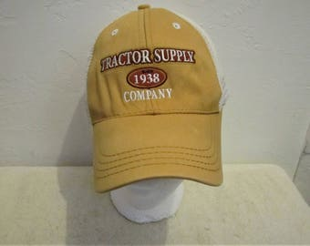 A GRUNGED Vintage 90's Gold & White Mesh TRACTOR SUPPLY Cap.One Size