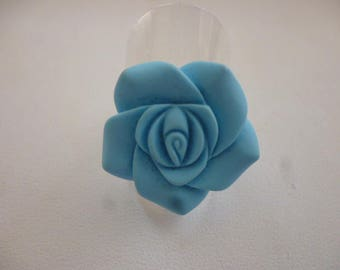 Turquoise and silver resin rose ring.