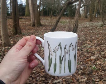 China Mug with Snowdrop designs illustrated by Alice Draws The Line. Modern botanical illustrations of snowdrops on a tea or coffee cup