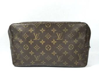 Authentic Louis Vuitton purse. Louis Vuitton Trousse pouch. Louis Vuitton cosmetic bag. Louis Vuitton Monogram pouch. Louis Vuitton toilette
