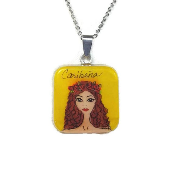 Caribeña from The Yellow Crowd collection. karla menendez fashion illustration, resin pendant with stainless steel chain.