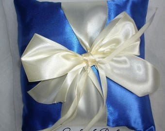 Blue Duchess satin ring pillow and her large ivory bow