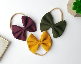 Maroon, mustard, and green hair bows