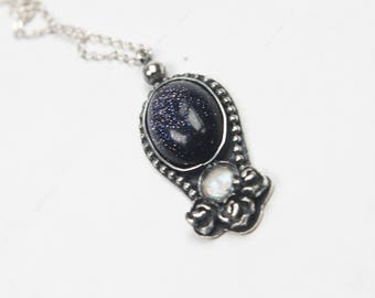 silver pendant with moonstone and black venturina
