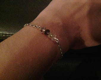 Purple and white bead and silver plated chain bracelet