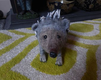 a needle felted hedghog sculpture