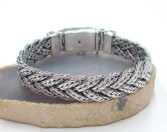Woven bracelet with two braided chain classic clasp with safety