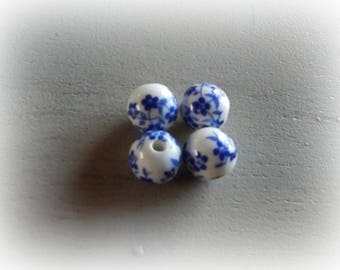 4 white ceramic flower patterned blue 12 mm round beads