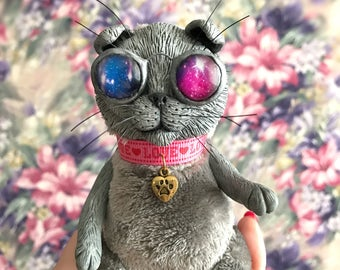 Space glasses cat. Scottishfold cat. Grey plush soft toy. Clay kitten