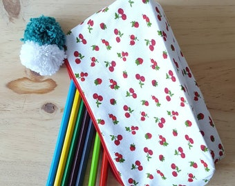 Makeup or pens with tassels and cherry print clutch