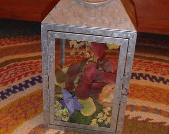 Lantern with preserved fall foliage and flowers