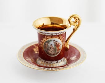 Deepred porcelain Versailles-style demitasse, cameo after A. Kauffman, goldcolor décor, marked , tall handle, 1970s
