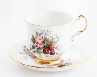 PARAGON by appointment to Her Majesty small teacup and saucer,delicate raspberries dessin, goldgilt rims and foot, 1970