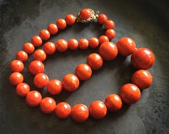 Bakelite beaded necklace. Bold strand in hot cayenne red.