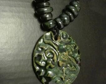Jade ceramic medal with beads
