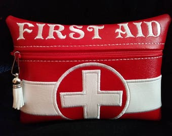 Take along Frist Aid zipper bag.  Beauty bag purse wallet