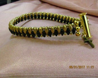 Tailored Black and Gold Bracelet