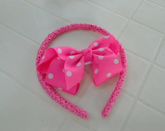 Pink headband dressed with crocheted recycled plastic bags, detachable hair clip, pink bow with white dots