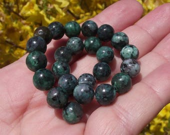 RUBY ZOISITE 8 MM ROUND BEADS 4. *.