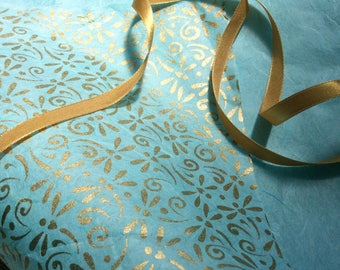 Original dragonfly design gift wrap / craft paper, screen printed with gold ink on turquoise background
