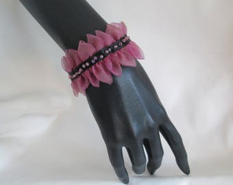 Bracelet with organza petals, in the Center a satin ribbon and seed beads