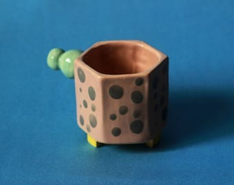 Polka-dotted small espresso cup