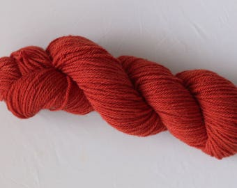 red plant dyed 100% wool yarn