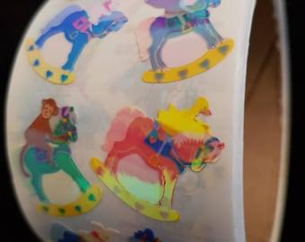Plastic sticker roll with 50 breaks rocking horse