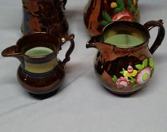 Set Of Four Copper Luster Hand Painted Creamer Pitchers
