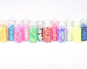 12 mini bottles of glitter in different colors
