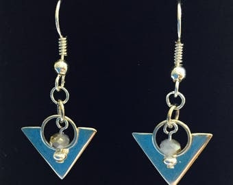 Geometric sterling earrings with pale blue/beige crystals.