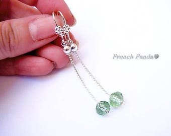 Silver plated chain and green Crystal silver stud earrings.