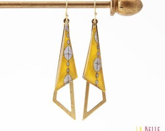 Earrings are made of resinees yellow wax print