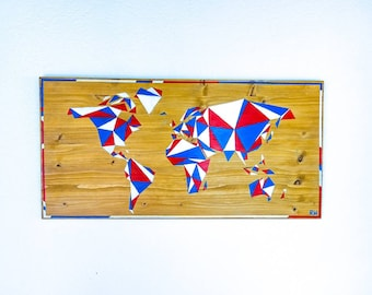 White red painting on wood - blue world map