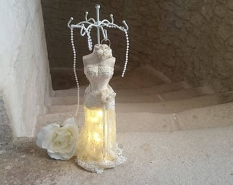Jewelry holder mannequin and lace dress bright